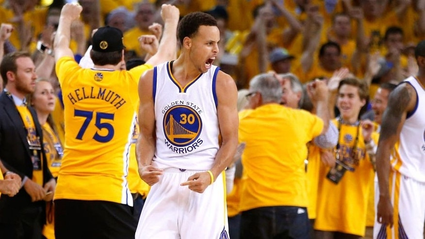OAKLAND, CA - MAY 21: Stephen Curry #30 and Klay Thompson #11 of the Golden State Warriors react after defeating the Houston Rockets during game two of the Western Conference Finals of the 2015 NBA PLayoffs at ORACLE Arena on May 21, 2015 in Oakland, California. NOTE TO USER: User expressly acknowledges and agrees that, by downloading and or using this photograph, user is consenting to the terms and conditions of Getty Images License Agreement. (Photo by Ezra Shaw/Getty Images)
