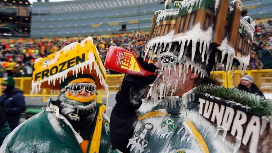 <p>Sunday, January 5: Green Bay Packers fans jokingly deal with frigid temperatures before an NFL wild-card playoff football game.</p>
