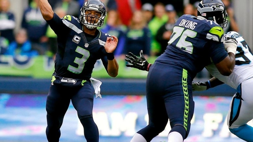 SEATTLE, WA - OCTOBER 18: Quarterback Russell Wilson #3 of the Seattle Seahawks throws the ball against the Carolina Panthers at CenturyLink Field on October 18, 2015 in Seattle, Washington. (Photo by Jonathan Ferrey/Getty Images)
