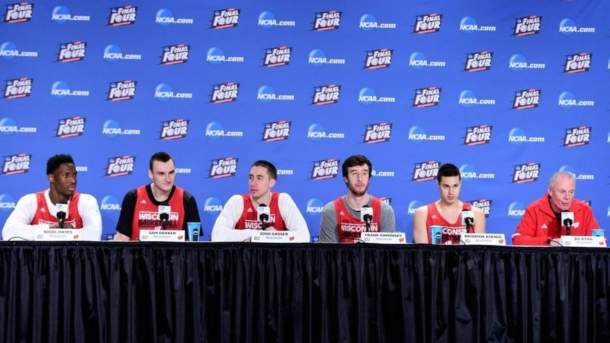 <p>Apr 5, 2015; Indianapolis, IN, USA; Left to right are Wisconsin Badgers forwards Nigel Hayes (10) and Sam Dekker (15) and guard Josh Gasser (21) and forward Frank Kaminsky (44) and guard Bronson Koenig (24) and head coach Bo Ryan during the Wisconsin press conference at Lucas Oil Stadium. Mandatory Credit: Bob Donnan-USA TODAY Sports</p>