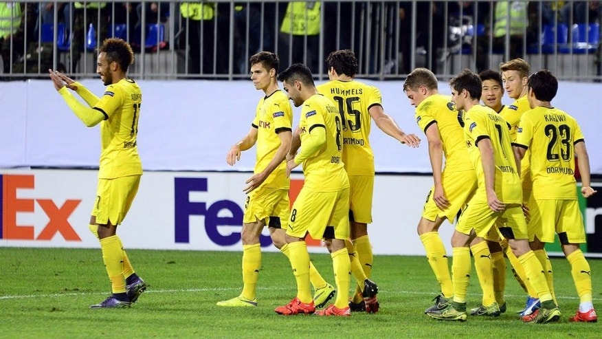 Dortmund's players celebrate a goal during the UEFA Europa League group C football match between Qabala FK and Borussia Dortmund in Baku on October 22, 2015. AFP PHOTO / TOFIK BABAYEV (Photo credit should read TOFIK BABAYEV/AFP/Getty Images)
