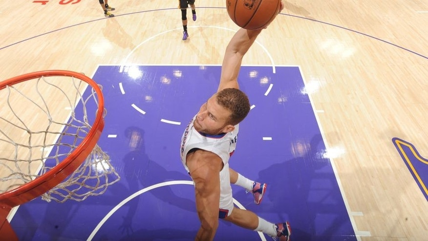 LOS ANGELES, CA - OCTOBER 31: Blake Griffin #32 of the Los Angeles Clippers dunks against the Los Angeles Lakers on October 30, 2014 at the Staples Center in Los Angeles, California. NOTE TO USER: User expressly acknowledges and agrees that, by downloading and/or using this Photograph, user is consenting to the terms and conditions of Getty Images License Agreement. Mandatory Copyright Notice: Copyright 2014 NBAE (Photo by Andrew D. Bernstein/NBAE via Getty Images)