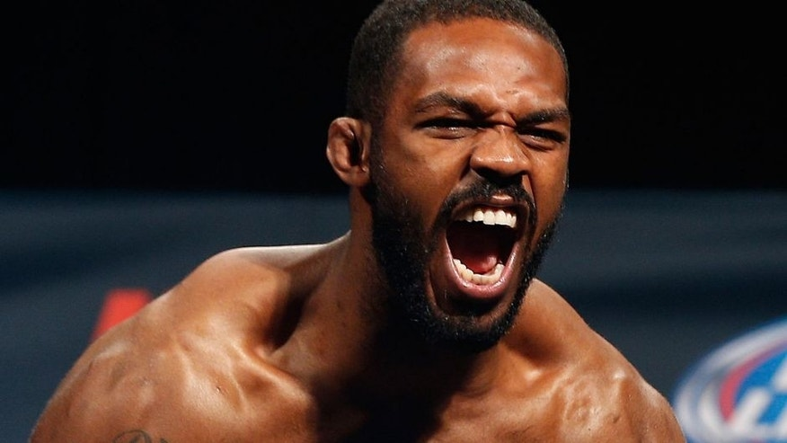 """LAS VEGAS, NV - JANUARY 02: UFC light heavyweight champion Jon """"Bones"""" Jones poses on the scale after weighing in during the UFC 182 weigh-in event at the MGM Grand Conference Center on January 2, 2015 in Las Vegas, Nevada. (Photo by Josh Hedges/Zuffa LLC/Zuffa LLC via Getty Images)"""