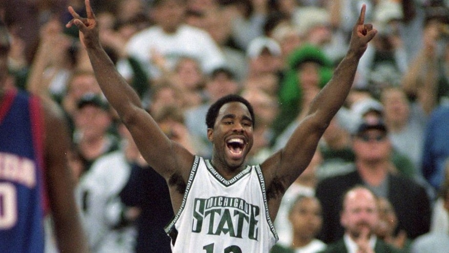 3 Apr 2000: Mateen Cleaves #12 of the Michigan State Spartans celebrates on the floor during the NCAA Men''s Finals Four Game against the Florida Gators at the RCA Dome in Indianapolis, Indiana. The Spartans defeated the Gators 89-76. Mandatory Credit: Jed Jacobsohn /Allsport