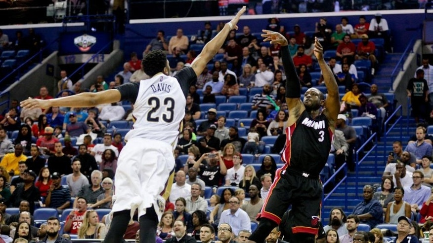 Oct 23, 2015; New Orleans, LA, USA; Miami Heat guard Dwyane Wade (3) shoots over New Orleans Pelicans forward Anthony Davis (23) during the second quarter of a game at the Smoothie King Center. Mandatory Credit: Derick E. Hingle-USA TODAY Sports