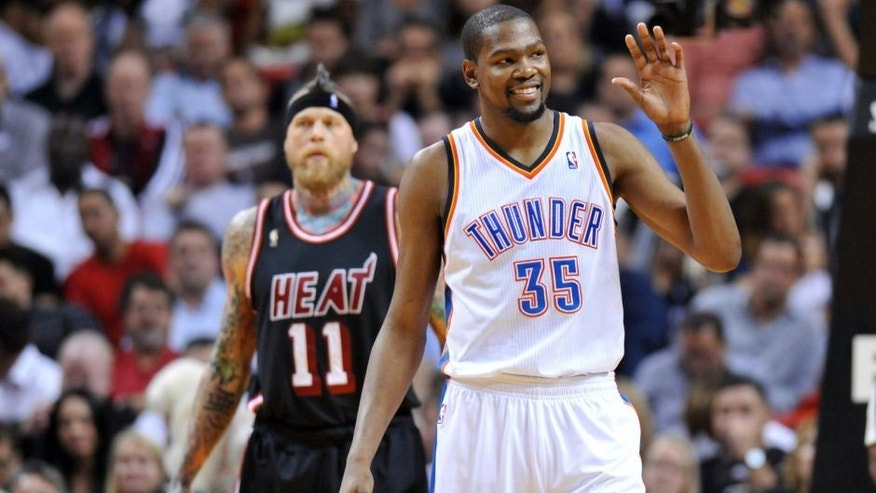 Jan 29, 2014; Miami, FL, USA; Oklahoma City Thunder small forward Kevin Durant (35) reacts in front of Miami Heat power forward Chris Andersen (11) during the second half at American Airlines Arena. Mandatory Credit: Steve Mitchell-USA TODAY Sports