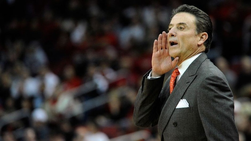 Nov 24, 2014; Louisville, KY, USA; Louisville Cardinals head coach Rick Pitino calls out instructions during the first half against the Savannah State Tigers at KFC Yum! Center. Mandatory Credit: Jamie Rhodes-USA TODAY Sports