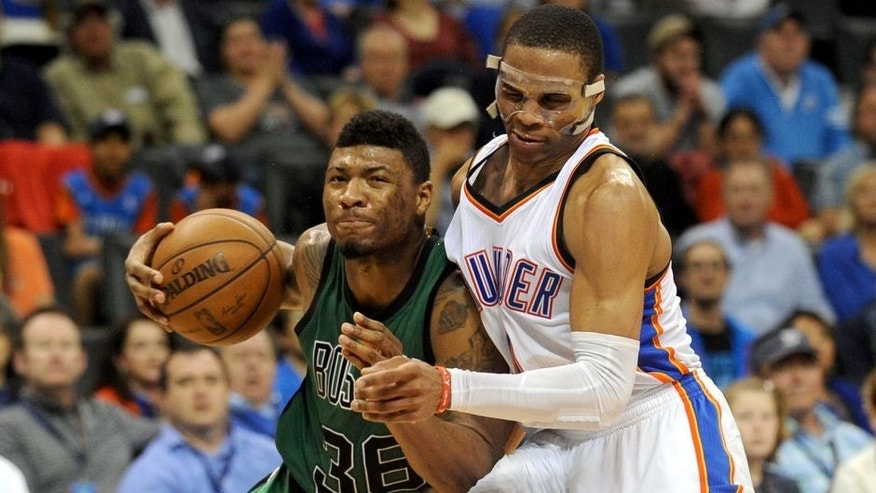 Mar 18, 2015; Oklahoma City, OK, USA; Boston Celtics guard Marcus Smart (36) drives to the basket after colliding with Oklahoma City Thunder guard Russell Westbrook (0) during the fourth quarter at Chesapeake Energy Arena. Mandatory Credit: Mark D. Smith-USA TODAY Sports