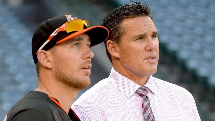ANAHEIM, CA - AUGUST 26: Jeff Mathis #6 of the Miami Marlins talks to assistant general manager Scott Servais of the Los Angeles Angels of Anaheim before the game on August 26, 2014 at Angel Stadium of Anaheim in Anaheim, California. (Photo by Matt Brown/Angels Baseball LP/Getty Images)