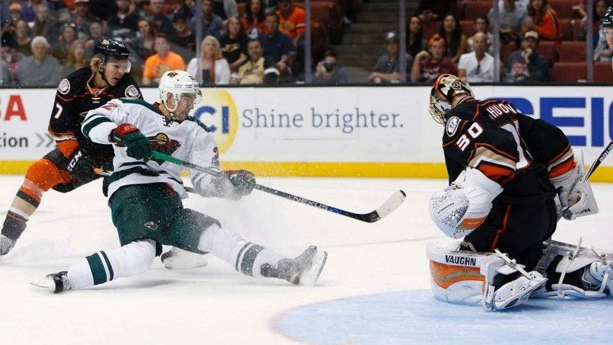 The Anaheim Ducks' Hampus Lindholm (left) can't stop the Minnesota Wild's Nino Niederreiter from scoring a goal past Anaheim Ducks goalie Anton Khudobin in the first period in Anaheim, Calif., on Sunday, Oct. 18, 2015.