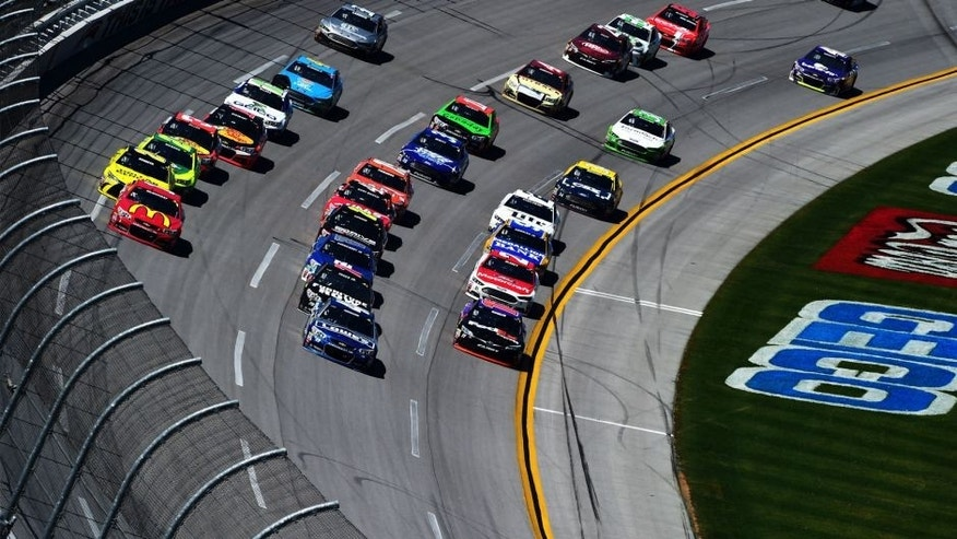 TALLADEGA, AL - MAY 03: Jimmie Johnson, driver of the #48 Lowe's Chevrolet, leads the field during the NASCAR Sprint Cup Series GEICO 500 at Talladega Superspeedway on May 3, 2015 in Talladega, Alabama. (Photo by Jared C. Tilton/Getty Images)
