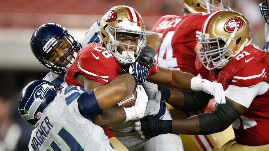 SANTA CLARA, CA - OCTOBER 22: Carlos Hyde #28 of the San Francisco 49ers rushes with the ball against the Seattle Seahawks during their NFL game at Levi's Stadium on October 22, 2015 in Santa Clara, California. (Photo by Ezra Shaw/Getty Images)