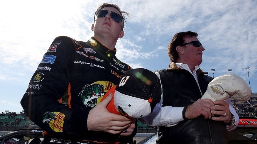 KANSAS CITY, KS - OCTOBER 17: Ty Dillon, driver of the #3 Bass Pro Shops/Big Cedar Lodge Chevrolet, stands on the grid with Richard Childress prior to the NASCAR XFINITY Series Kansas Lottery 300 at Kansas Speedway on October 17, 2015 in Kansas City, Kansas. (Photo by Todd Warshaw/Getty Images)