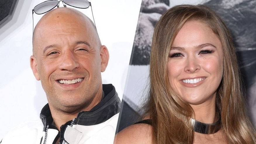 "HOLLYWOOD, CA - APRIL 01: Actor Vin Diesel arrives at the Los Angeles premiere of ""Furious 7"" at TCL Chinese Theatre IMAX on April 1, 2015 in Hollywood, California. (Photo by Gregg DeGuire/WireImage), HOLLYWOOD, CA - APRIL 01: Ronda Rousey arrvies at the ""Furious 7"" - Los Angeles Premiere at TCL Chinese Theatre IMAX on April 1, 2015 in Hollywood, California. (Photo by Steve Granitz/WireImage)"