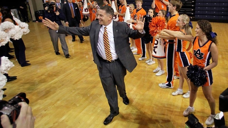 Mar 18, 2014; Auburn, AL, USA; Auburn Tigers basketball coach Bruce Pearl is welcomed by the crowd prior to his introductory press conference in the Auburn Arena on Tuesday. Mandatory Credit: John Reed-USA TODAY Sports