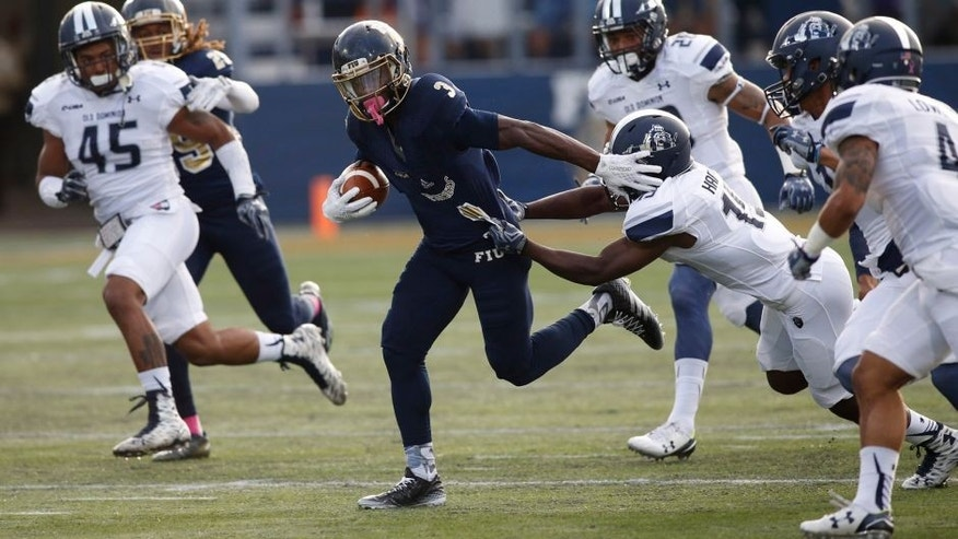 Oct 24, 2015; Miami, FL, USA; FIU Golden Panthers cornerback Richard Leonard (3) returns a kick off as Old Dominion Monarchs wide receiver Isaiah Harper (15) attempts a tackle in the first half at FIU Stadium. Mandatory Credit: Robert Mayer-USA TODAY Sports