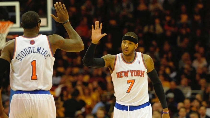 <p>New York Knicks small forward Carmelo Anthony (7) and power forward Amar'e Stoudemire (1) celebrate in the first quarter at Quicken Loans Arena.</p>