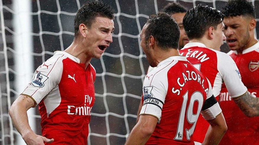 LONDON, ENGLAND - OCTOBER 24: Laurent Koscielny (L) of Arsenal celebrates scoring his team's second goal with his team mates during the Barclays Premier League match between Arsenal and Everton at Emirates Stadium on October 24, 2015 in London, England. (Photo by Dean Mouhtaropoulos/Getty Images)