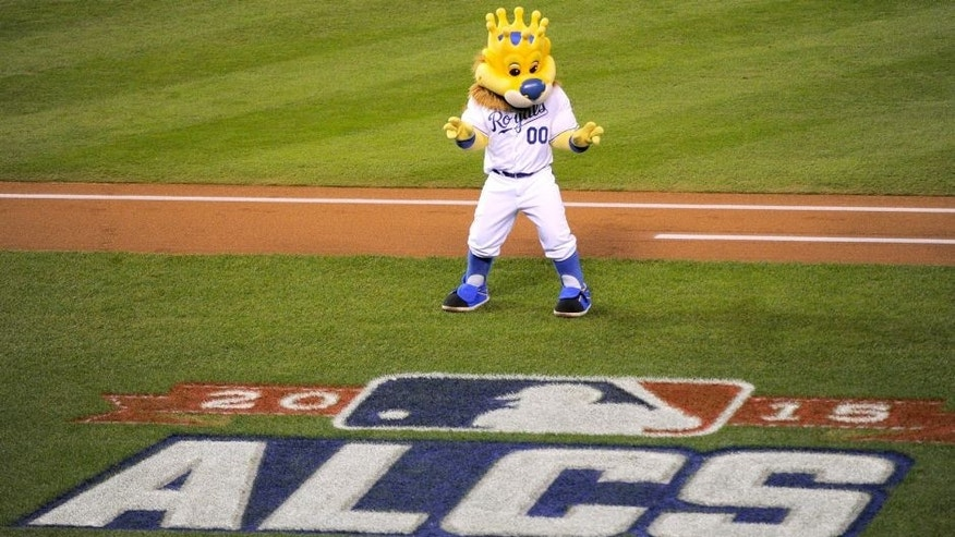 KANSAS CITY, MO - OCTOBER 23: Mascot Sluggerrr performs for the crowd before game six of the 2015 MLB American League Championship Series between the Kansas City Royals and the Toronto Blue Jays at Kauffman Stadium on October 23, 2015 in Kansas City, Missouri. (Photo by Ed Zurga/Getty Images)