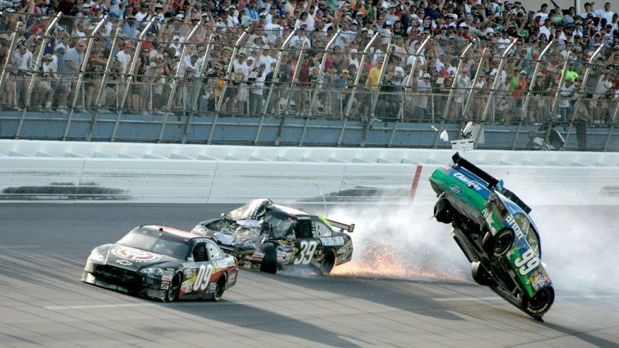 TALLADEGA, AL - APRIL 26: Carl Edwards, driver of the #99 Claritin Ford, goes airborne as Ryan Newman, driver of the #39 Steweart-Haas Racing Chevrolet suffers damage and Dale Earnhardt Jr., driver of the #88 National Guard / AMP Energy Chevrolet drives at the conclusion of the NASCAR Sprint Cup Series Aaron's 499 at Talladega Superspeedway on April 26, 2009 in Talladega, Alabama. (Photo by Jerry Markland/Getty Images for NASCAR) *** Local Caption *** Carl Edards;Ryan Edwards;Dale Earnhardt Jr.