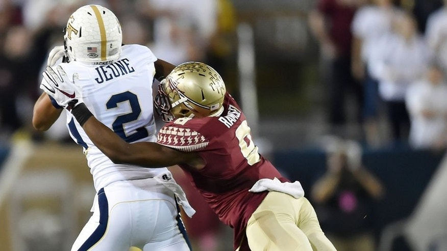 Florida State defensive back Jalen Ramsey (8) breaks up a pass for Georgia Tech wide receiver Ricky Jeune (2) during the first half of an NCAA college football game, Saturday, Oct. 24, 2015, in Atlanta. (AP Photo/Jon Barash)