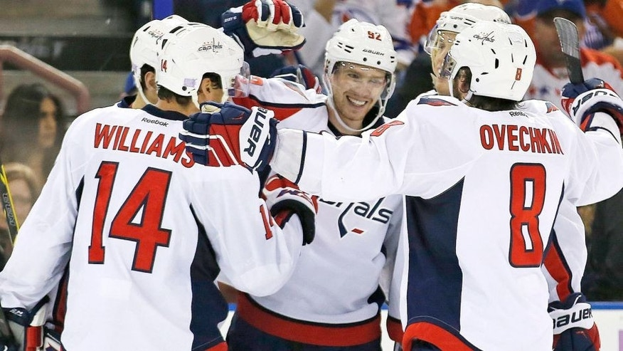 Oct 23, 2015; Edmonton, Alberta, CAN; The Washington Capitals forward Evgeny Kuznetsov (92) celebrates with teammates after scoring a goal in the third goal during the third period at Rexall Place. Mandatory Credit: Perry Nelson-USA TODAY Sports