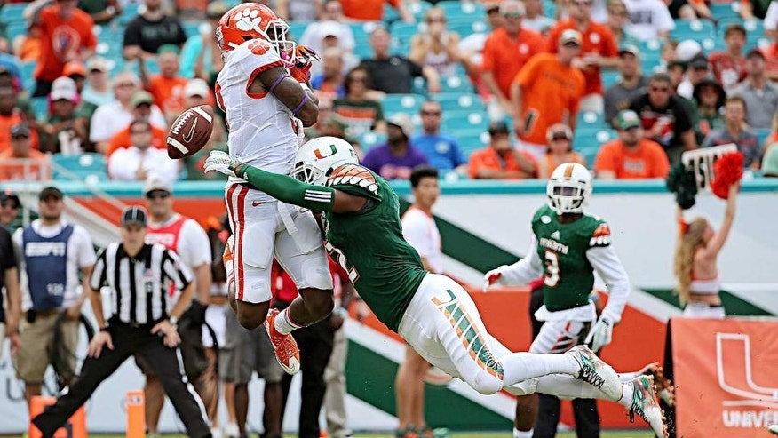 MIAMI GARDENS, FL - OCTOBER 24: Artavis Scott #3 of the Clemson Tigers misses a pass defended by Mackensie Alexander #2 of the Clemson Tigers during a game at Sun Life Stadium on October 24, 2015 in Miami Gardens, Florida. (Photo by Mike Ehrmann/Getty Images)