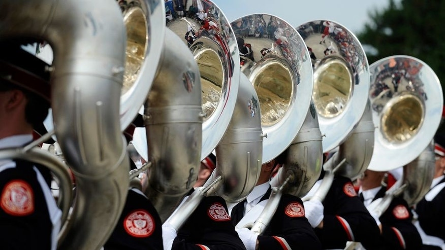 LEXINGTON, OHIO - AUGUST 17: The Ohio State University marching band performs before the Nationwide Children's Hospital 200 at Mid-Ohio Sports Car Course on August 17, 2013 in Lexington, Ohio. (Photo by Rainier Ehrhardt/Getty Images)