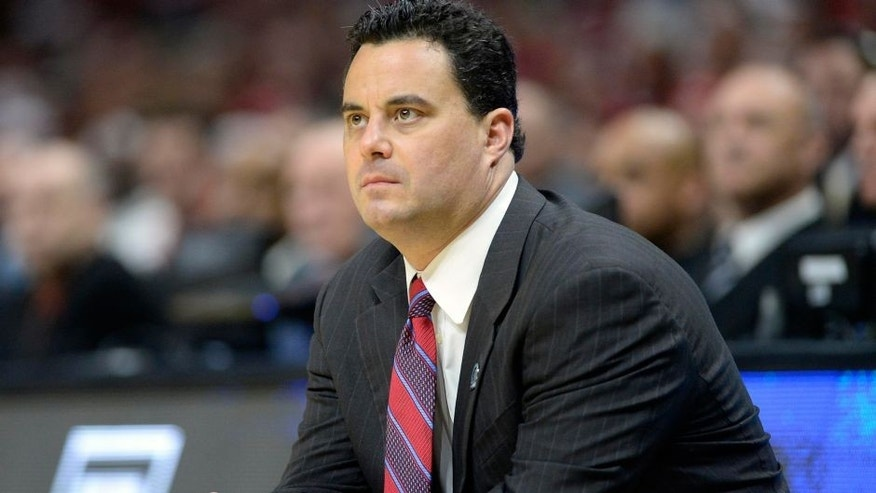 <p>Mar 28, 2015; Los Angeles, CA, USA; Arizona Wildcats head coach Sean Miller watches game action against Wisconsin Badgers during the first half in the finals of the west regional of the 2015 NCAA Tournament at Staples Center. Mandatory Credit: Richard Mackson-USA TODAY Sports ,Mar 28, 2015; Los Angeles, CA, USA; Arizona Wildcats head coach Sean Miller watches game action against Wisconsin Badgers during the first half in the finals of the west regional of the 2015 NCAA Tournament at Staples Center. Mandatory Credit: Richard Mackson-USA TODAY Sports</p>