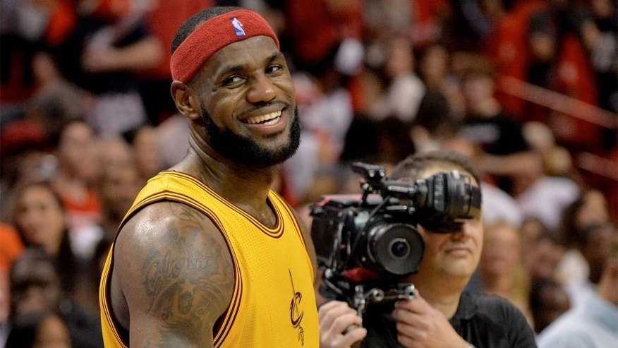 Dec 25, 2014; Miami, FL, USA; Cleveland Cavaliers forward LeBron James (23) smiles after losing to the Miami Heat at American Airlines Arena. The Heat won 101-91. Mandatory Credit: Steve Mitchell-USA TODAY Sports