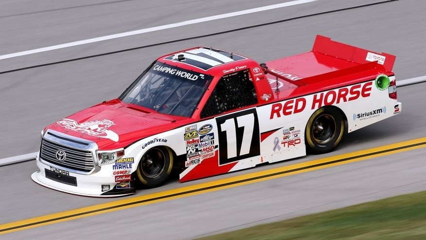 TALLADEGA, AL - OCTOBER 24: Timothy Peters, driver of the #17 Red Horse Racing Toyota, qualifies for the NASCAR Camping World Truck Series fred's 250 at Talladega Superspeedway on October 24, 2015 in Talladega, Alabama. (Photo by Todd Warshaw/Getty Images)