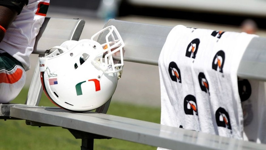 Sep 28, 2013; Tampa, FL, USA; Miami Hurricanes helmet on the bench against the South Florida Bulls during the second half at Raymond James Stadium. Miami Hurricanes defeated the South Florida Bulls 49-21. Mandatory Credit: Kim Klement-USA TODAY Sports
