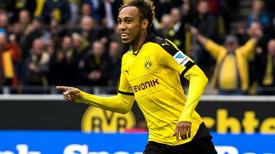 Dortmund's Gabonese midfielder Pierre-Emerick Aubameyang (R) celebrates scoring the opening goal during the German first division football Bundesliga match between Borussia Dortmund and FC Augsburg on October 25, 2015 in Dortmund, western Germany. AFP PHOTO / ODD ANDERSEN RESTRICTIONS: DURING MATCH TIME: DFL RULES TO LIMIT THE ONLINE USAGE TO 15 PICTURES PER MATCH AND FORBID IMAGE SEQUENCES TO SIMULATE VIDEO. ==RESTRICTED TO EDITORIAL USE == FOR FURTHER QUERIES PLEASE CONTACT THE DFL DIRECTLY AT + 49 69 650050. (Photo credit should read ODD ANDERSEN/AFP/Getty Images)