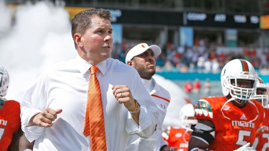 MIAMI GARDENS, FL - SEPTEMBER 19: Head coach Al Golden of the Miami Hurricanes runs onto the field with the team prior to the game against the Nebraska Cornhuskers on September 19, 2015 at Sun Life Stadium in Miami Gardens, Florida. Miami defeated Nebraska 36-33 in overtime. (Photo by Joel Auerbach/Getty Images)