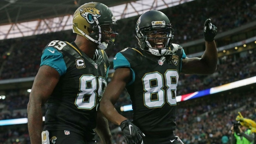 Jacksonville Jaguars wide receiver Allen Hurns (88), right, celebrates after catching the ball for a touchdown during the NFL game between Buffalo Bills and Jacksonville Jaguars at Wembley Stadium in London, Sunday, Oct. 25, 2015. (AP Photo/Tim Ireland)