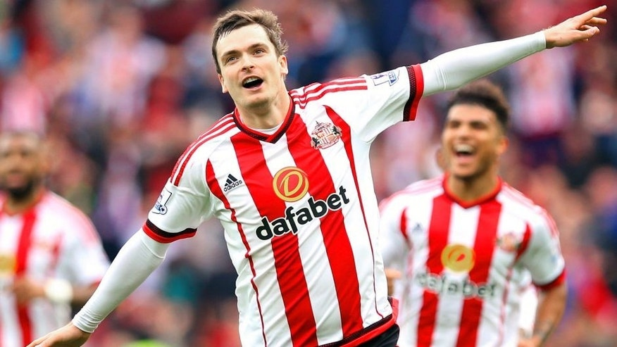 SUNDERLAND, ENGLAND - OCTOBER 25: Adam Johnson of Sunderland celebrates scoring his team's first goal from the penalty spot during the Barclays Premier League match between Sunderland and Newcastle United at Stadium of Light on October 25, 2015 in Sunderland, England. (Photo by Ian MacNicol/Getty Images)