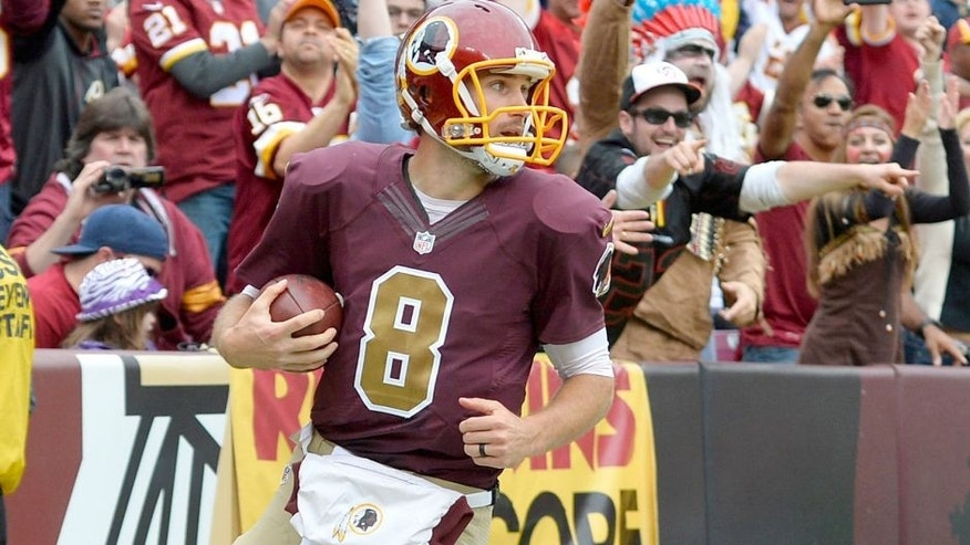 Oct 25, 2015; Landover, MD, USA; Washington Redskins quarterback Kirk Cousins (8) celebrates after scoring a running touchdown during the second quarter against the Tampa Bay Buccaneers at FedEx Field. Mandatory Credit: Tommy Gilligan-USA TODAY Sports