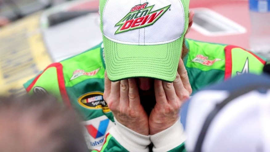 TALLADEGA, AL - OCTOBER 25: Dale Earnhardt Jr., driver of the #88 Diet Mountain Dew Chevrolet, reacts on pit road after the NASCAR Sprint Cup Series CampingWorld.com 500 at Talladega Superspeedway on October 25, 2015 in Talladega, Alabama. (Photo by Sarah Crabill/Getty Images)