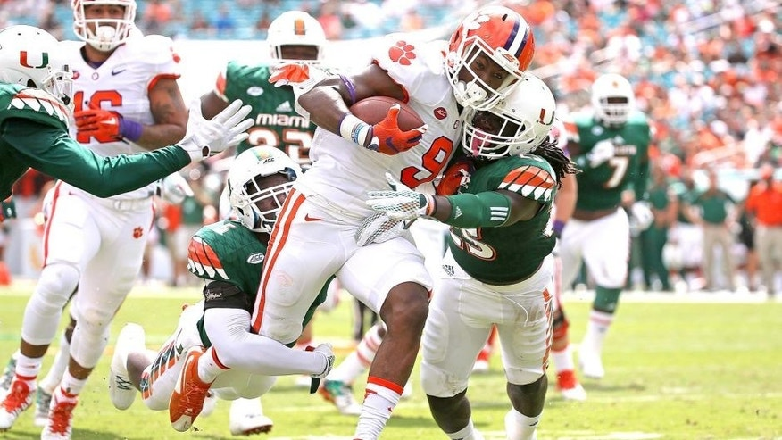 MIAMI GARDENS, FL - OCTOBER 24: Wayne Gallman #9 of the Clemson Tigers rushes for a touchdown during a game against the Miami Hurricanes at Sun Life Stadium on October 24, 2015 in Miami Gardens, Florida. (Photo by Mike Ehrmann/Getty Images)