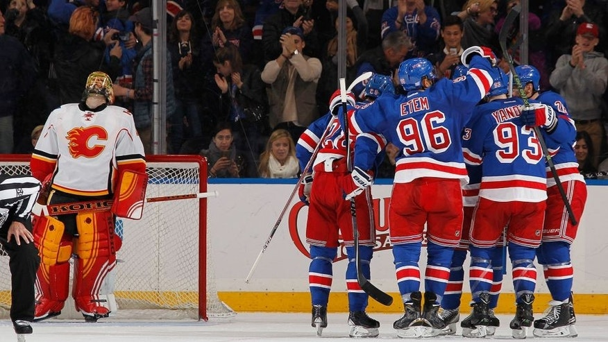 <p>NEW YORK, NY - OCTOBER 25: Dan Girardi #5, Emerson Etem #96, Keith Yandle #93 and Dominic Moore #28 of the New York Rangers celebrate after scoring a second period goal against Jonas Hiller #1 of the Calgary Flames at Madison Square Garden on October 25, 2015 in New York City. (Photo by Jared Silber/NHLI via Getty Images)</p>