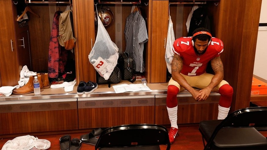 SANTA CLARA, CA - OCTOBER 4: Colin Kaepernick #7 of the San Francisco 49ers listens to music alone in the lcoker room prior to the game against the Green Bay Packers at Levi Stadium on October 4, 2015 in Santa Clara, California. The Packers defeated the 49ers 17-3. (Photo by Michael Zagaris/San Francisco 49ers/Getty Images)