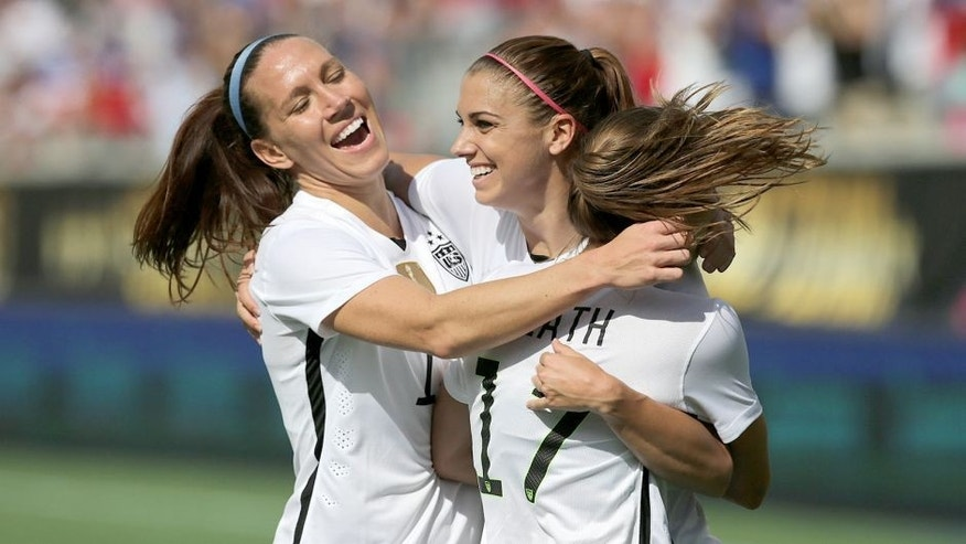 ORLANDO, FL - OCTOBER 25: Lauren Holiday #12, Alex Morgan #13, and Tobin Heath #17 of USWNT celebrate a goal during a women's international friendly soccer match between Brazil and the United States at the Orlando Citrus Bowl on October 25, 2015 in Orlando, Florida. (Photo by Alex Menendez/Getty Images)
