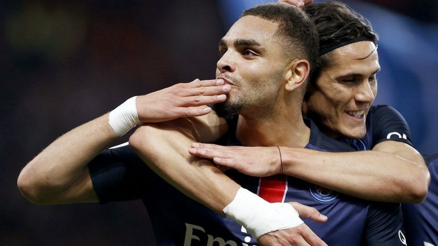 PARIS, FRANCE - OCTOBER 25: Layvin Kurzawa of PSG celebrates scoring the first goal of PSG with Edinson Cavani of PSG during the French Ligue 1 match between Paris Saint-Germain (PSG) and AS Saint-Etienne (ASSE) at Parc des Princes stadium on October 25, 2015 in Paris, France. (Photo by Jean Catuffe/Getty Images)