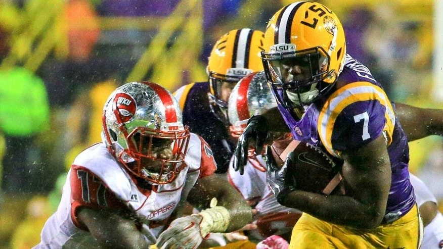 Oct 24, 2015; Baton Rouge, LA, USA; LSU Tigers running back Leonard Fournette (7) runs against the Western Kentucky Hilltoppers during the second quarter of a game at Tiger Stadium. Mandatory Credit: Derick E. Hingle-USA TODAY Sports