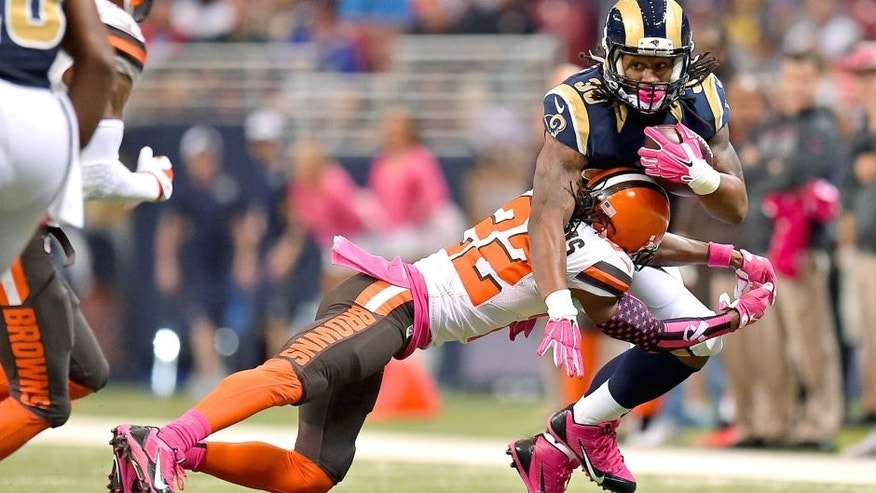 Oct 25, 2015; St. Louis, MO, USA; Cleveland Browns cornerback Tramon Williams (22) tackles St. Louis Rams running back Todd Gurley (30) during the first half at the Edward Jones Dome. Mandatory Credit: Jasen Vinlove-USA TODAY Sports