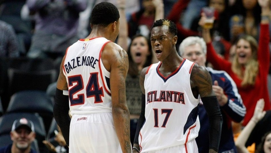 Dec 2, 2014; Atlanta, GA, USA; Atlanta Hawks guard Kent Bazemore (24) and guard Dennis Schroder (17) celebrate after a made basket against the Boston Celtics in the fourth quarter at Philips Arena. The Hawks defeated the Celtics 109-105. Mandatory Credit: Brett Davis-USA TODAY Sports