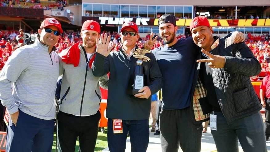 KANSAS CITY, MO - OCTOBER 25: Kansas City Royals Pedro Grifol, Drew Butera, Ned Yost, Eric Hosmer, and Salvador Perez are recognized with the American League Championship Trophy before the game between the Pittsburgh Steelers and the Kansas City Chiefs at Arrowhead Stadium on October 25, 2015 in Kansas City, Missouri. (Photo by Jamie Squire/Getty Images)