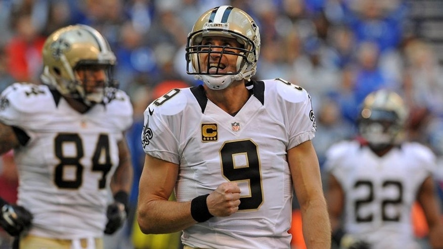 Oct 25, 2015; Indianapolis, IN, USA; New Orleans Saints quarterback Drew Brees (9) reacts after a dropped pass against the Indianapolis Colts in the first quarter at Lucas Oil Stadium. Mandatory Credit: Thomas J. Russo-USA TODAY Sports