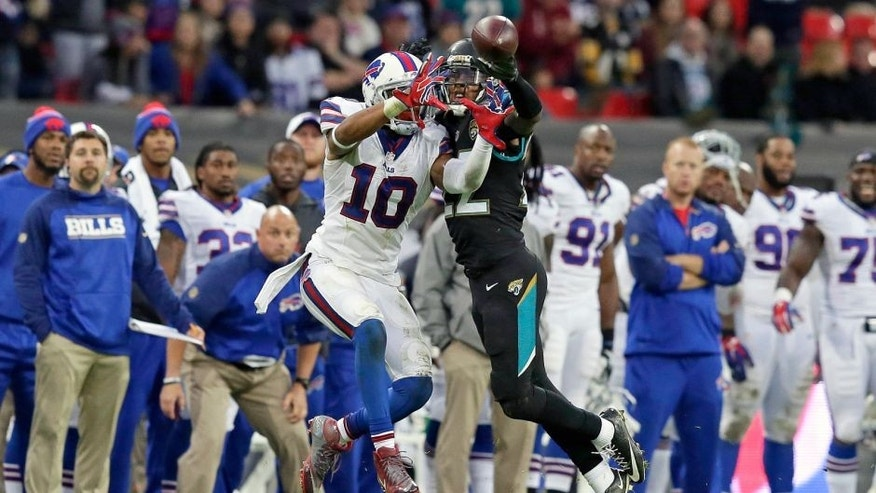 Jacksonville Jaguars cornerback Aaron Colvin (22), right, prevents Buffalo Bills wide receiver Robert Woods (10) from catching the ball during the NFL game between Buffalo Bills and Jacksonville Jaguars at Wembley Stadium in London, Sunday, Oct. 25, 2015. (AP Photo/Tim Ireland)