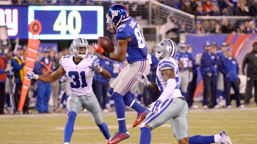 Oct 25, 2015; East Rutherford, NJ, USA; New York Giants wide receiver Rueben Randle (82) is unable to catch a pass between Dallas Cowboys defensive back Corey White (23) and cornerback Byron Jones (31) during the NFL game at MetLife Stadium. Mandatory Credit: Robert Deutsch-USA TODAY Sports